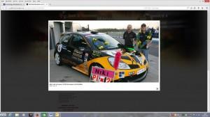 Screenshot von Lanik (mit Pokal) und seinem Wagen unter: http://de.youthforhumanrights.org/news/other/october-22-2007.html. DL 25.06.2014